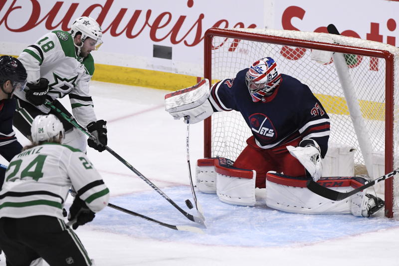 Connor's goal and 2 assists help Jets beat struggling Stars