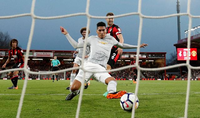 "Soccer Football - Premier League - AFC Bournemouth vs Manchester United - Vitality Stadium, Bournemouth, Britain - April 18, 2018 Manchester United's Chris Smalling scores their first goal Action Images via Reuters/John Sibley EDITORIAL USE ONLY. No use with unauthorized audio, video, data, fixture lists, club/league logos or ""live"" services. Online in-match use limited to 75 images, no video emulation. No use in betting, games or single club/league/player publications. Please contact your account representative for further details. TPX IMAGES OF THE DAY"