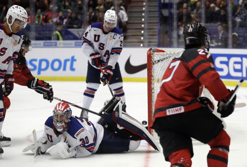Canada's Barett Hayton, right, scores sides fourth goal past goaltender Spencer Knight of the US during the U20 Ice Hockey Worlds match between Canada and the United States in Ostrava, Czech Republic, Thursday, Dec. 26, 2019. (AP Photo/Petr David Josek)