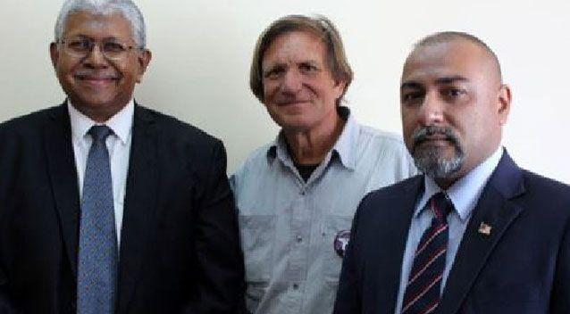 Malaysian investigator Aslam Khan, MH370 hunter Blaine Gibson and Malaysian Consul Zahid Raza, who was murdered last week, pictured at the Ministry of Transport in Madagascar last December. Source: Supplied