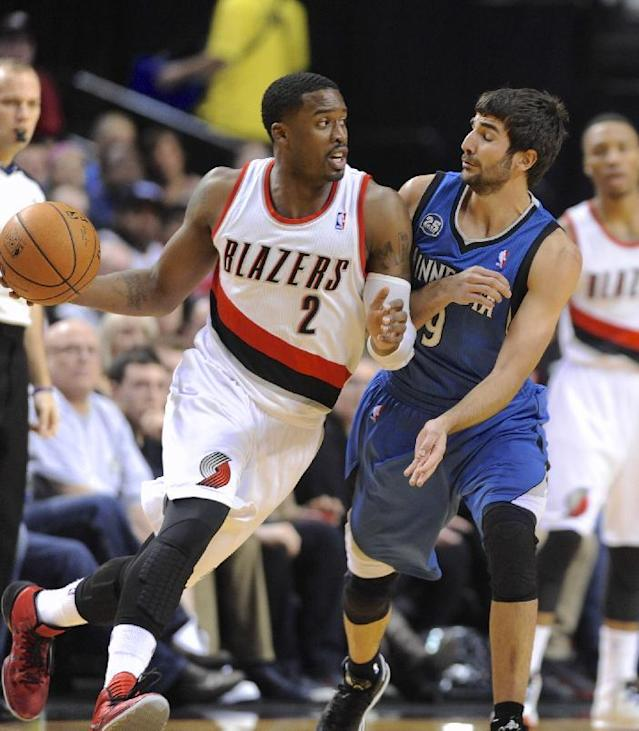 Minnesota Timberwolves' Ricky Rubio (9) defends against Portland Trail Blazers' Wesley Matthews (2) during the first half of an NBA basketball game in Portland, Ore., Sunday, Feb. 23, 2014. (AP Photo/Greg Wahl-Stephens)