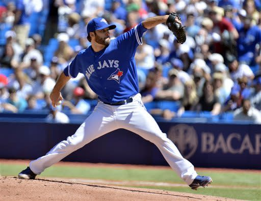Toronto Blue Jays starter Brandon Morrow pitches against the Seattle Mariners during first-inning baseball game action in Toronto, Sunday, May 5, 2013. (AP Photo/The Canadian Press, Nathan Denette)