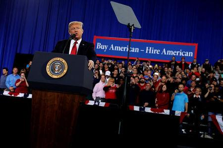 U.S. President Donald Trump delivers remarks at the American Center for Mobility, a test facility for driverless car technology for American Manufactured Vehicles in Ypsilanti Township, Michigan, U.S. March 15, 2017. REUTERS/Jonathan Ernst