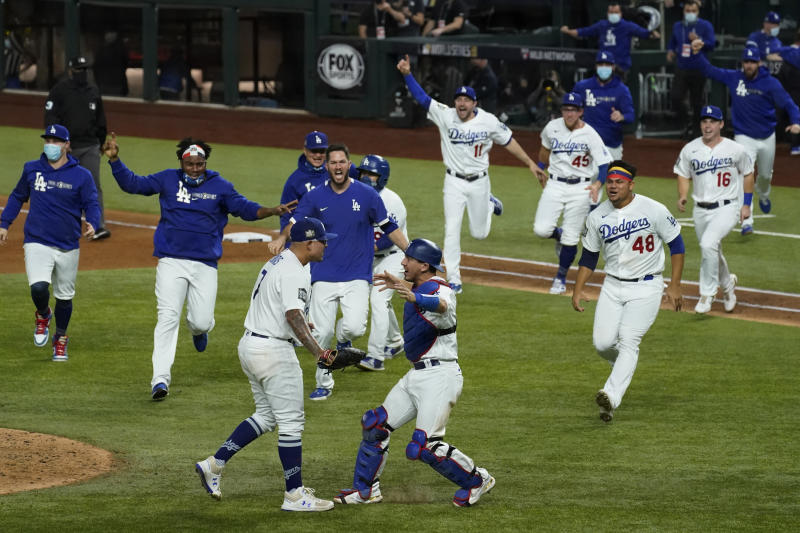 The Dodgers rush the field after defeating the Rays to win the World Series.