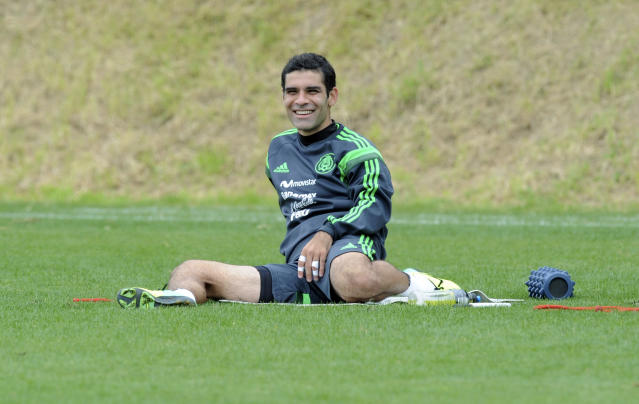 Mexico's captain Rafa Marquez smiles while training with his teammates in preparation for their upcoming World Cup qualifying soccer match against New Zealand, at Dave Farrington Park, in Wellington, New Zealand, Sunday, Nov. 17, 2013. (AP Photo/SNPA, Ross Setford) NEW ZEALAND OUT