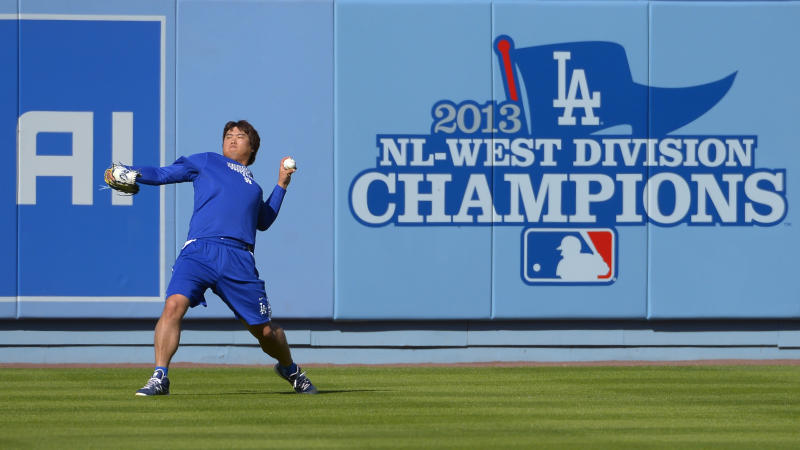 Los Angeles Dodgers starting pitcher Ryu Hyun-Jin, of South Korea, throws during practice for Game 3 of the National League baseball division series against the Atlanta Braves, Saturday, Oct. 5, 2013, in Los Angeles. (AP Photo/Mark J. Terrill)