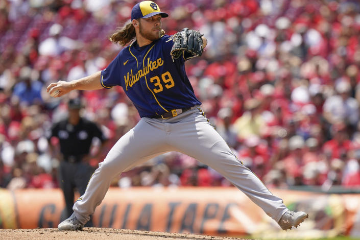 Milwaukee Brewers starting pitcher Corbin Burnes (39) throws during the first inning of a baseball game against the Cincinnati Reds in Cincinnati, Sunday, July 18, 2021. (AP Photo/Bryan Woolston)