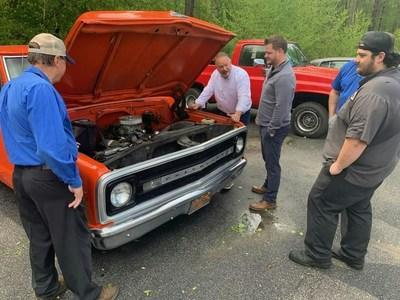 Title: Classic Car Restoration Competition | Caption: Hiester Automotive Group technicians, pictured from left Jimmy Dorman, dealer John Hiester, Brandon Pettigrew and Brendan Davis,  worked on restoring classic cars for an online auction to raise money for charity during the Covid-19 pandemic.