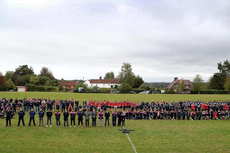 Players observe a minute's silence at East Grinstead rugby club, Kent, to pay their respects to police officer Sergeant Matt Ratana who was the head coach at the club. (PA)