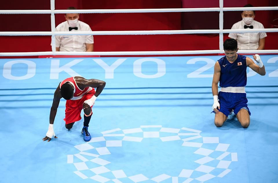 <p>Ryomei Tanaka of Japan, right, after being declared victorious over Yuberjen Herney Martinez Rivas of Colombia during their men's flyweight quarter-final bout at the Kokugikan Arena during the 2020 Tokyo Summer Olympic Games in Tokyo, Japan. (Photo By Stephen McCarthy/Sportsfile via Getty Images)</p>