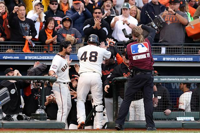 SAN FRANCISCO, CA - OCTOBER 24: Pablo Sandoval #48 of the San Francisco Giants celebrates with his teammates in the dugout after hitting a solo home run to center field against Justin Verlander #35 of the Detroit Tigers in first inning during Game One of the Major League Baseball World Series at AT&T Park on October 24, 2012 in San Francisco, California. (Photo by Christian Petersen/Getty Images)