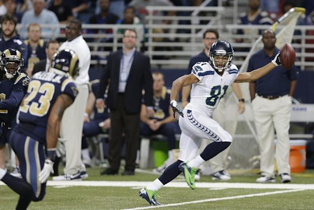 Seattle Seahawks wide receiver Golden Tate (81) runs to the end zone for a touchdown during the second half of an NFL football game against the St. Louis Rams, Monday, Oct. 28, 2013, in St. Louis. (AP Photo/Michael Conroy)