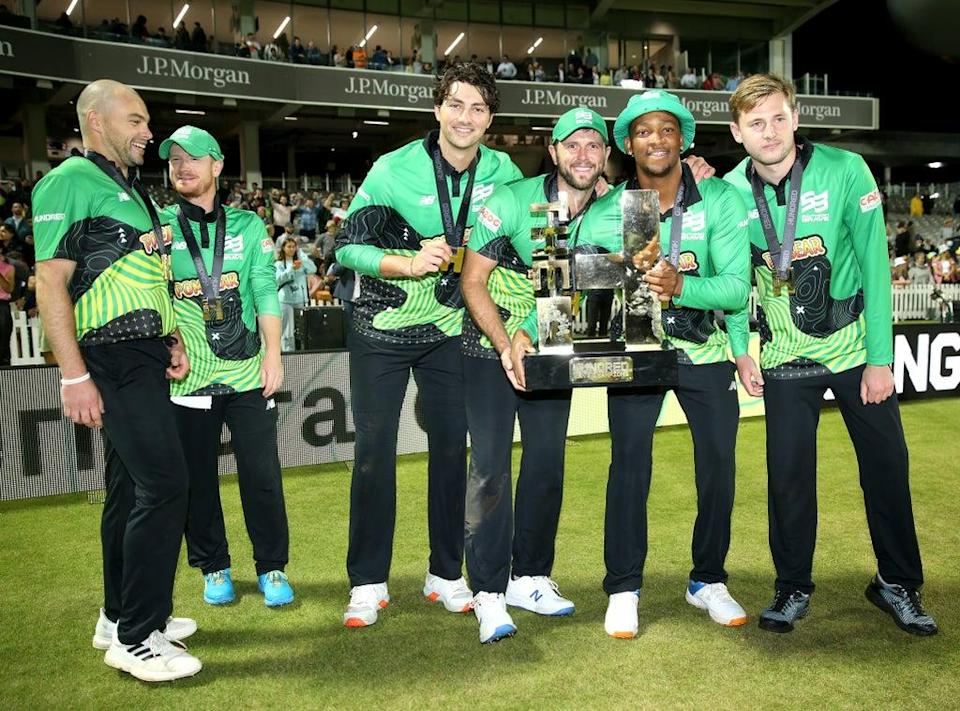 Southern Brave players lift the inaugural Hundred trophy (Steven Paston/PA) (PA Wire)