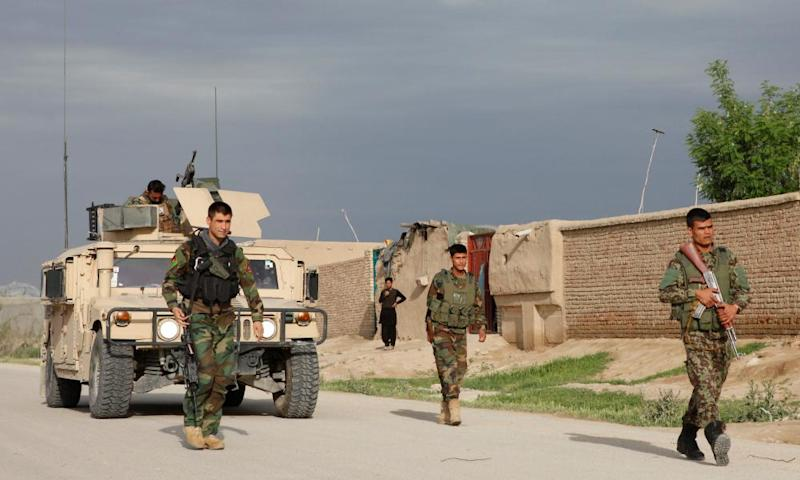 Afghan national army troops arrive near the site of an ongoing attack on an army headquarters in northern Afghanistan on 21 April 2017.