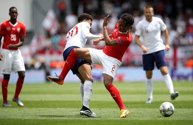 Alli and Switzerland's Kevin Mbabu battle for the ball (Tim Goode/PA)