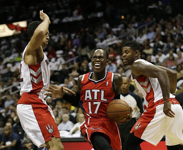 Atlanta Hawks point guard Dennis Schroder (17), of Germany, drives between Toronto Raptors small forward Rudy Gay, left, and Toronto Raptors power forward Amir Johnson in the first half of an NBA basketball game Friday, Nov. 1, 2013, in Atlanta. (AP Photo/John Bazemore)