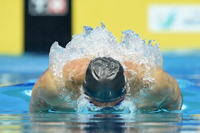 Olympic swimming hopeful Joseph Schooling, pictured on September 25, 2014, sent records tumbling as he grabbed two SEA Games golds (AFP Photo/Philippe Lopez)