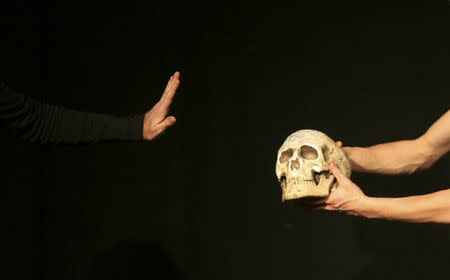 """File photograph of an actor performing during William Shakespeare's theatre play """"Hamlet"""""""