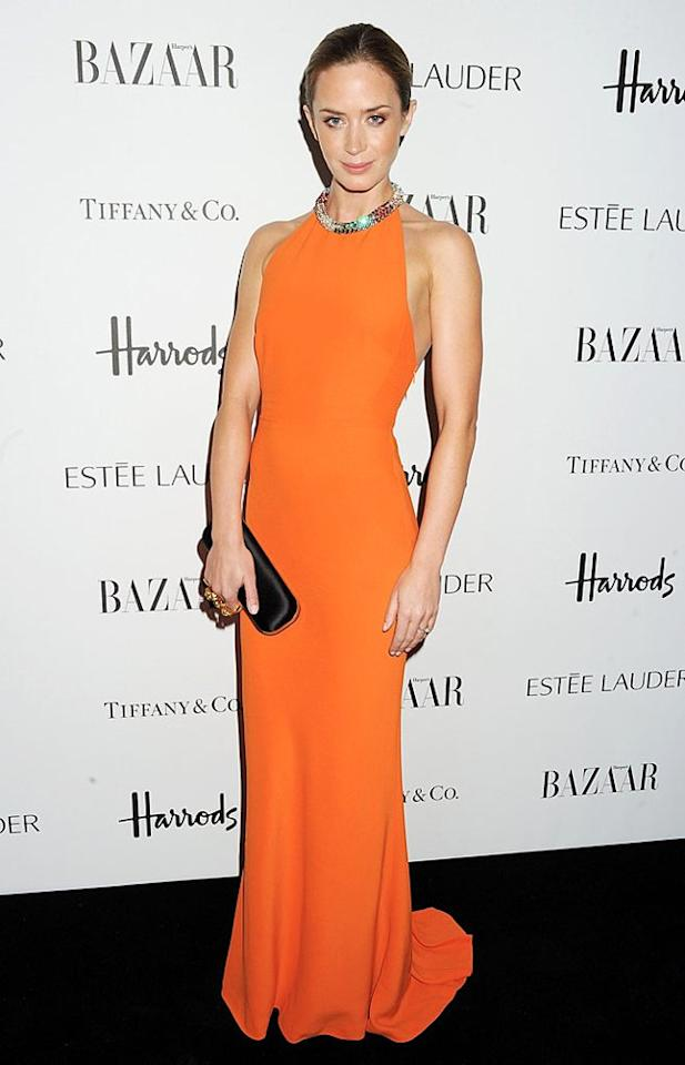 Emily Blunt was -- without a doubt -- the best-dressed celeb in attendance at last week's Women of the Year Awards, which were held at Claridge's hotel in London. Upon arriving at the fete, the actress posed for photographers in her tangerine-hued Alexander McQueen halterneck dress (complete with bedazzled neckline), while carrying a black satin McQueen clutch. (10/31/2012)