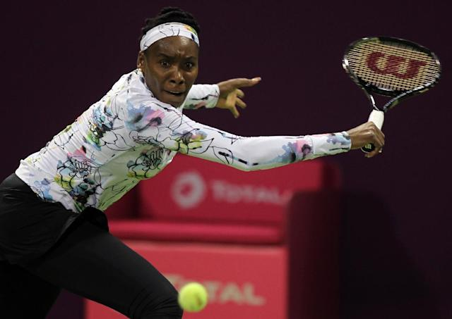 Venus Williams of the U.S. returns the ball to Petra Kvitova of the Czech Republic during the third day of the WTA Qatar Ladies Open in Doha, Qatar, Wednesday, Feb. 12, 2014. (AP Photo/Osama Faisal)
