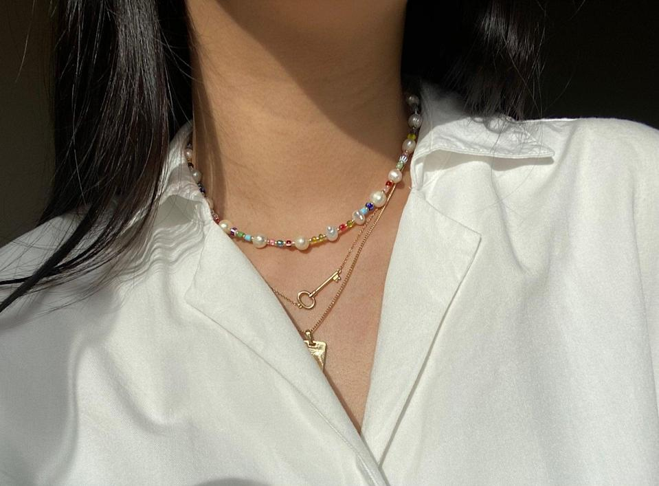 <p>This <span>Freshwater Pearl Beaded Necklace</span> ($25) is so pretty to look at.</p>