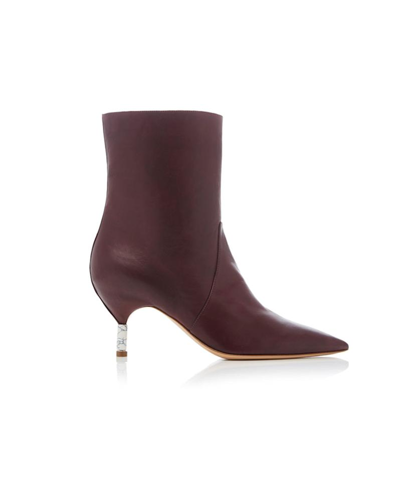 """<p>Gabriela Hearst is a fan favorite among royals and celebrities. Meghan Markle, Mandy Moore, and Zoë Kravitz are all fans of the designer. These burgundy boots have a sophisticated tiny marble heel and are a major steal at 75 percent off the retail price. Hurry, though, there was only one size left at publication time. Don't worry — you can find even more deals online at <a rel=""""nofollow"""" href=""""https://fave.co/2QvtO60"""">Moda Operandi's major sitewide sale</a>. <br /><a rel=""""nofollow"""" href=""""https://fave.co/2SJDXhg""""><strong>Shop it:</strong> </a>$299 (was $1,195), <a rel=""""nofollow"""" href=""""https://fave.co/2SJDXhg"""">modaoperandi.com</a> </p>"""