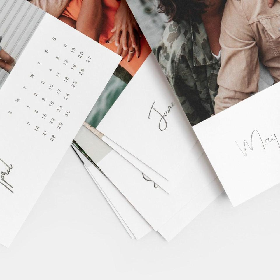 """Tug at your grandma's heartstrings with a custom calendar of cherished family memories. It's the perfect gift to lift her spirits during these challenging times and remind her of the special occasions with her favorite people. $25, Artifact Uprising. <a href=""""https://www.artifactuprising.com/photo-prints/custom-photo-calendar"""" rel=""""nofollow noopener"""" target=""""_blank"""" data-ylk=""""slk:Get it now!"""" class=""""link rapid-noclick-resp"""">Get it now!</a>"""