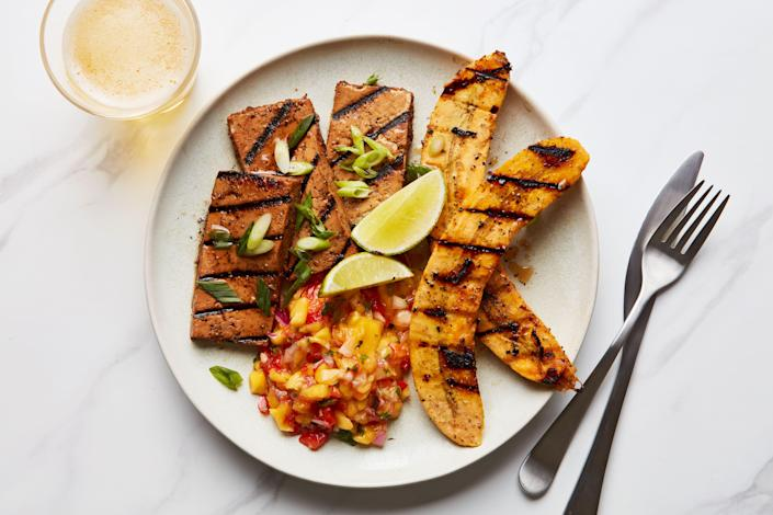 """Tofu has a knack for soaking up flavor, so it's wonderful marinated with allspice, thyme, garlic, brown sugar, and Scotch bonnet peppers. A fresh mango salsa and grilled plantains round out the dish. <a href=""""https://www.epicurious.com/recipes/food/views/grilled-jerk-tofu-plantains-mango-salsa-vegan?mbid=synd_yahoo_rss"""" rel=""""nofollow noopener"""" target=""""_blank"""" data-ylk=""""slk:See recipe."""" class=""""link rapid-noclick-resp"""">See recipe.</a>"""