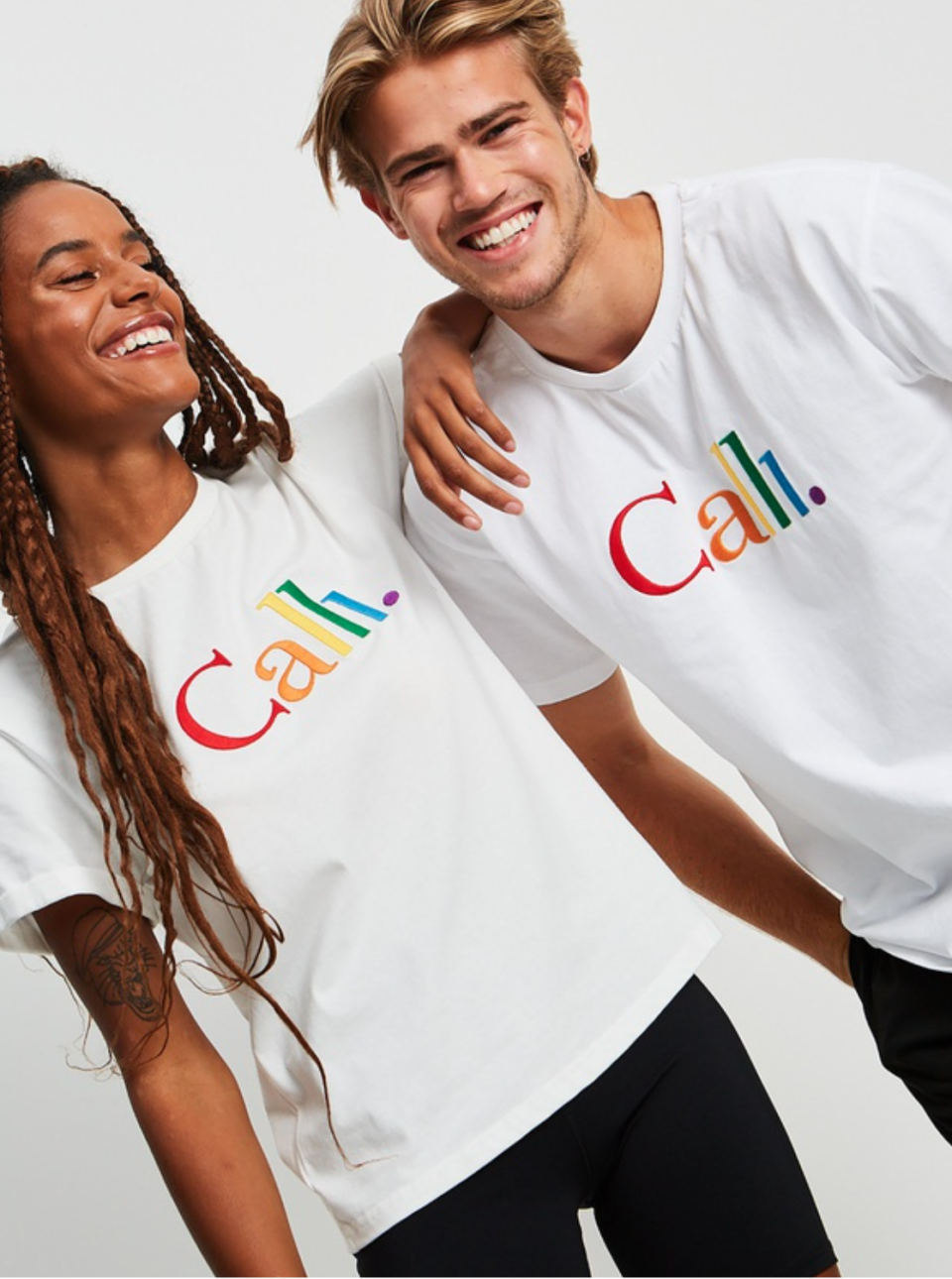 Two people wearing Calli's Sydney mardi gras T-shirts