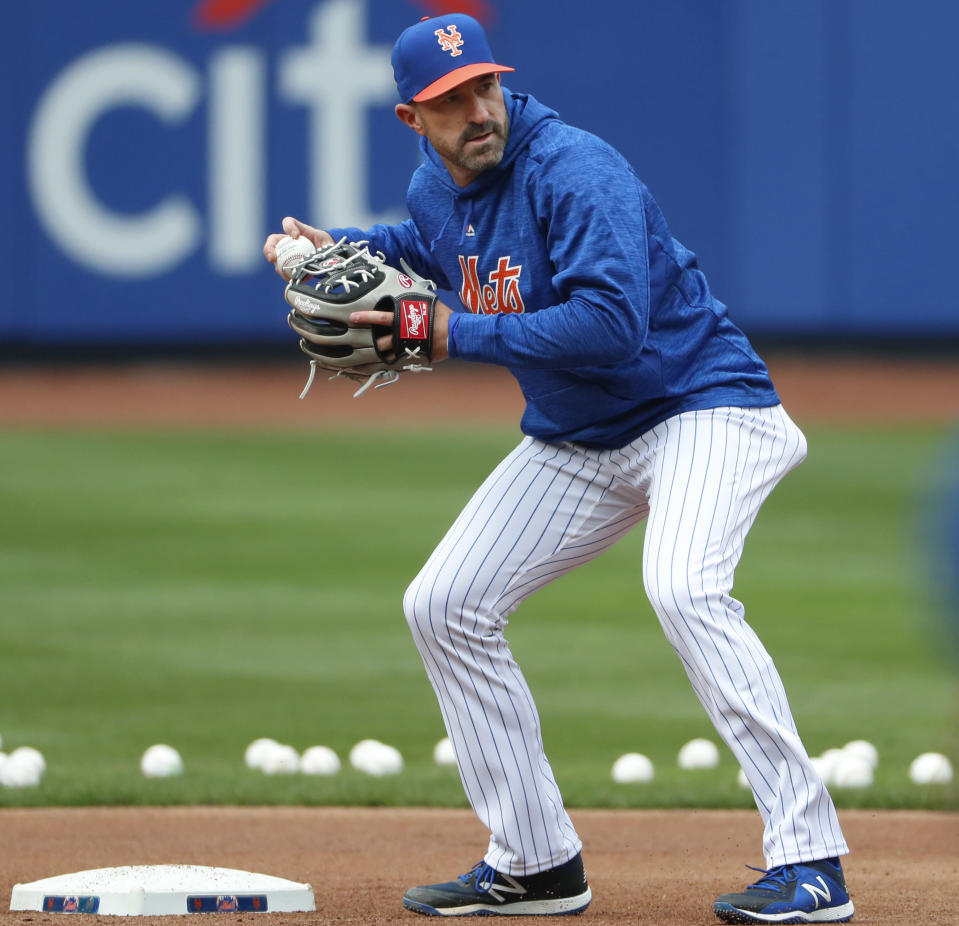 New York Mets manager Mickey Callaway sets up to throw to first base during a team workout at Citi Field, Wednesday, March 28, 2018, in New York. The team's opening day is Thursday. (AP Photo/Kathy Willens)