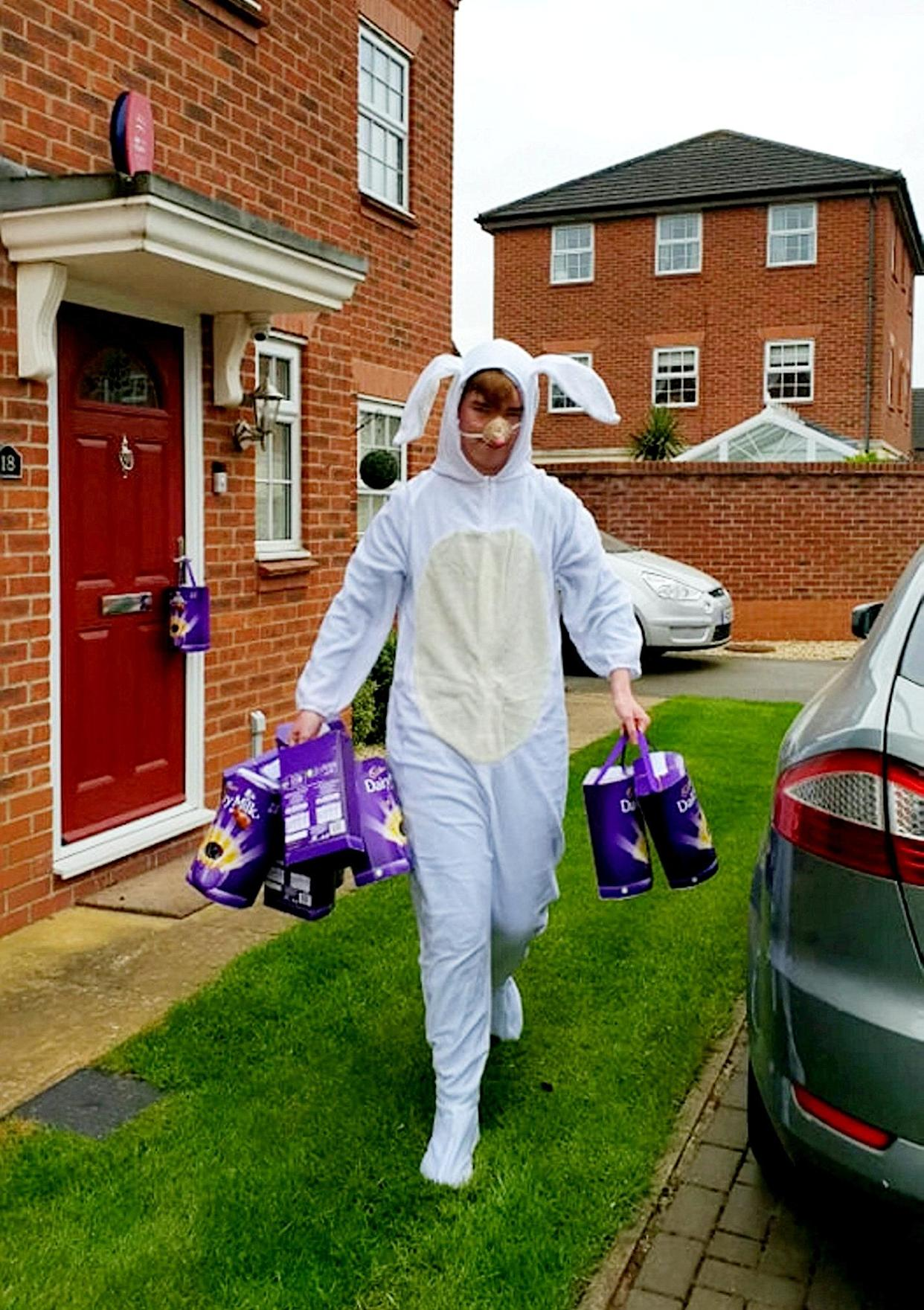 Sebbie Hall dressed as an Easter bunny to hand out 365 chocolate eggs which were donated to him for his challenge. (Supplied Ashley Hall/SWNS)