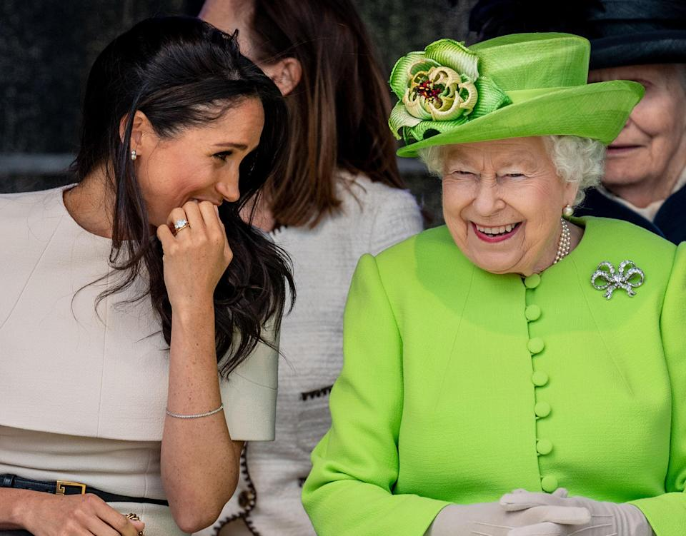 Meghan Markle and Queen Elizabeth share a laugh during their trip to Cheshire. (Photo: Mark Cuthbert/UK Press via Getty Images)