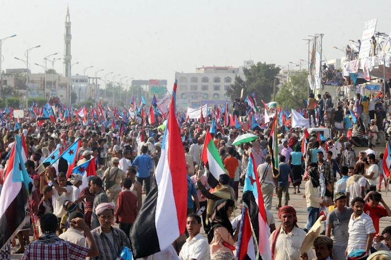 Yemeni supporters of the southern separatist movement wave the movement's flag during a rally calling for independence of the south, in Aden in May 2017