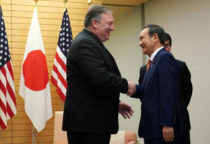 """Secretary of State Mike Pompeo (L) speaks to Japan's then-Chief Cabinet Secretary Yoshihide Suga at the prime minister's office in Tokyo on Oct. 6, 2018. <span class=""""copyright"""">Eugene Hoshiko—AFP/Getty Images</span>"""