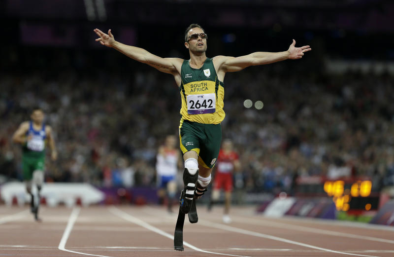 FILE - In this Saturday, Sept. 8, 2012 file photo, South Africa's Oscar Pistorius wins gold in the men's 400-meter T44 final at the 2012 Paralympics, in London. The man who racing commentators said was slow from the starting blocks, Pistorius went on to win many medals for his running prowess, but is now expected to testify in his own defense during his trial in South Africa for the killing of his girlfriend Reeva Steenkamp. (AP Photo/Kirsty Wigglesworth, File)