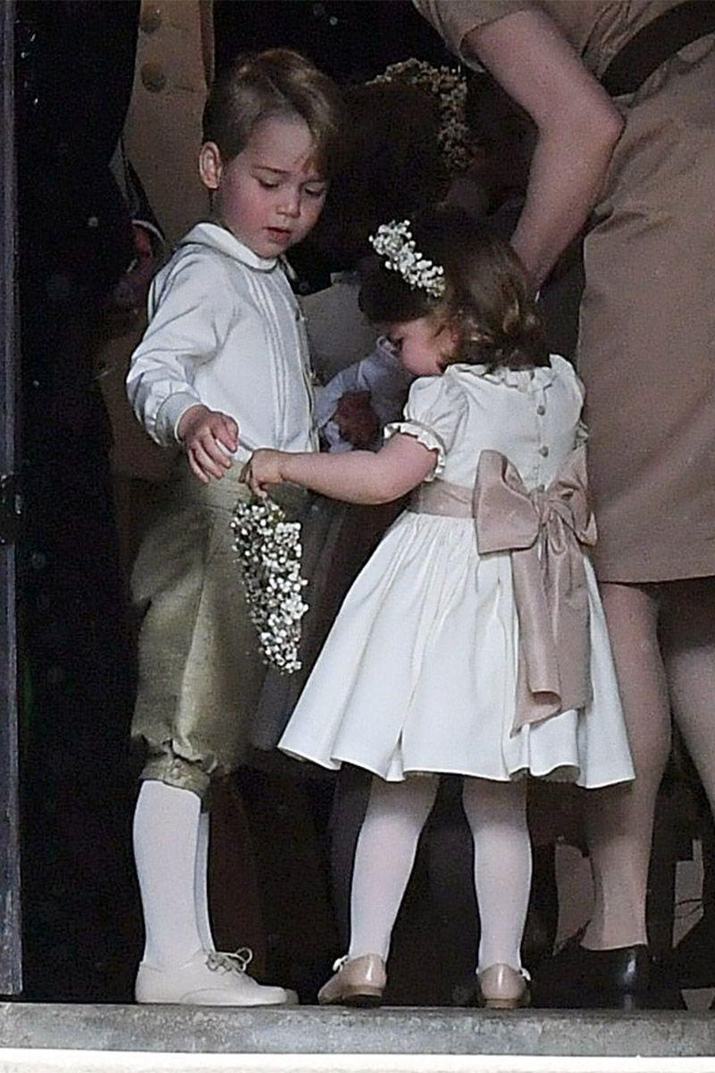 <p>Prince George and Princess Charlotte serve as pageboy and bridesmaid at Pippa Middleton's wedding to James Matthews at St Mark's Church in Englefield Green, England.</p>