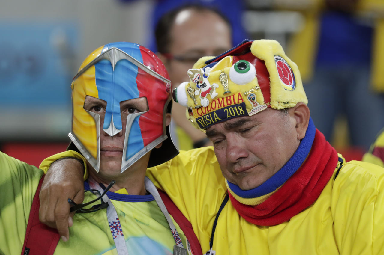 <p>Colombian fans reacts after England defeated Colombia in a penalty shoot out during the round of 16 match between Colombia and England at the 2018 soccer World Cup in the Spartak Stadium, in Moscow, Russia, Tuesday, July 3, 2018. (AP Photo/Ricardo Mazalan) </p>