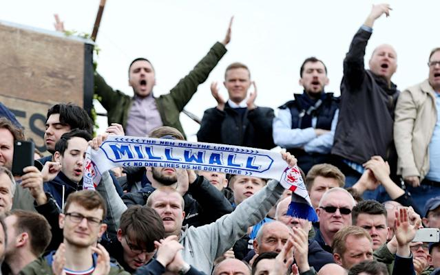 These Millwall fans will be delighted with their TV-viewing options from August... Provided they all leave the country - Rex Features