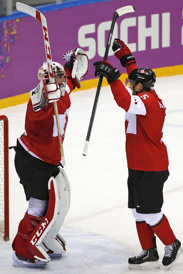 Goalkeeper Carey Price of Canada (31) and Dan Hamhuis of Canada (5) celebrate their 3-0 win over Sweden in the men's gold medal ice hockey game at the 2014 Winter Olympics, Sunday, Feb. 23, 2014, in Sochi, Russia. (AP Photo/Petr David Josek)