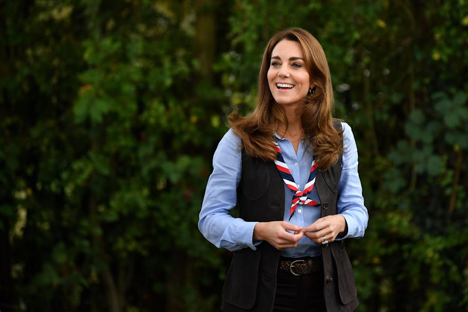 Britain's Catherine, Duchess of Cambridge, reacts as she arrives to visit a Scout Group in Northolt, northwest London on September 29, 2020, where she joined Cub and Beaver Scouts in outdoor activities. - The Duchess learned how the Scouts have adapted during the COVID-19 pandemic, and continued Scouting sessions and online activities. (Photo by Daniel LEAL-OLIVAS / various sources / AFP) (Photo by DANIEL LEAL-OLIVAS/AFP via Getty Images)