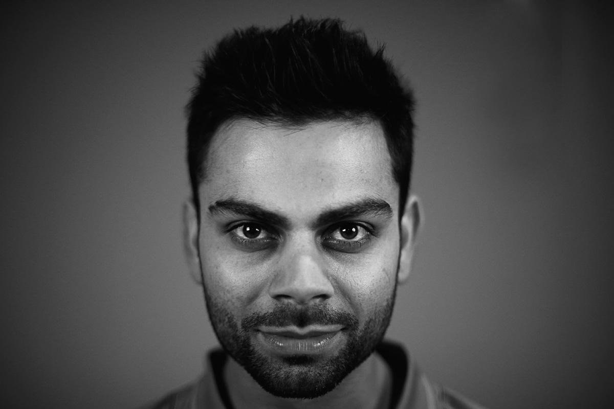 BIRMINGHAM, ENGLAND - MAY 30:  (Editors note: This image has been turned to Black and White) Virat Kohli of India poses during an India Portrait Session at the Hyatt Hotel ahead of the ICC Champions Trophy at Edgbaston on May 30, 2013 in Birmingham, England.  (Photo by Matthew Lewis-ICC/ICC via Getty Images)