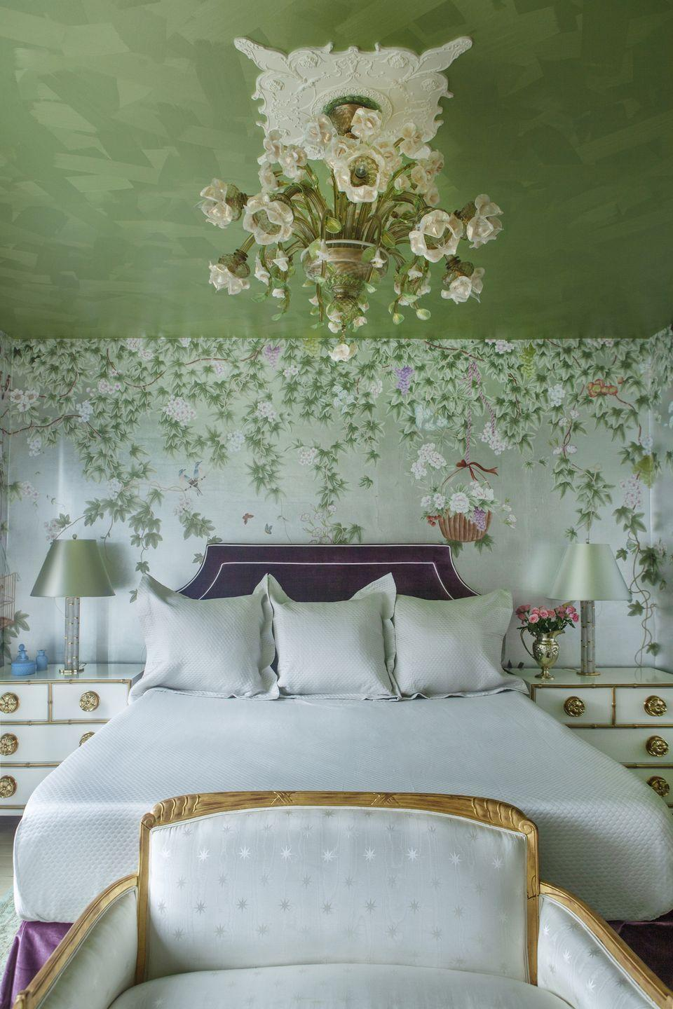 "<p>This fanciful Upper West Side bedroom designed by <a href=""https://sashabikoff.com/"" rel=""nofollow noopener"" target=""_blank"" data-ylk=""slk:Sasha Bikoff"" class=""link rapid-noclick-resp"">Sasha Bikoff</a> offers a modern taste of the gardens of Versailles with 18th-century French antiques, a luxurious silk wallcovering, and a statement light fixture above the bed. Two smaller bedside lamps ensure a softer glow will fill the space when needed.</p>"