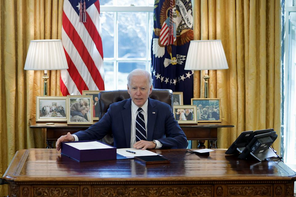 U.S. President Joe Biden looks on after signing the American Rescue Plan, a package of economic relief measures to respond to the impact of the coronavirus disease (COVID-19) pandemic, inside the Oval Office at the White House in Washington, U.S., March 11, 2021. REUTERS/Tom Brenner