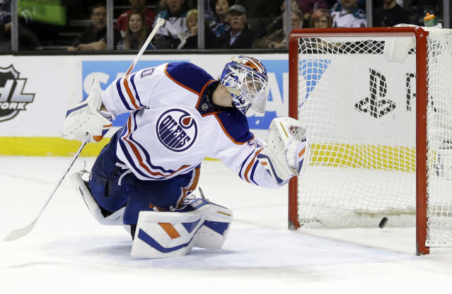 Edmonton Oilers goalie Devan Dubnyk is beaten for a goal on a shot from San Jose Sharks' Brent Burns during the first period of an NHL hockey game Thursday, Jan. 2, 2014, in San Jose, Calif. (AP Photo/Marcio Jose Sanchez)