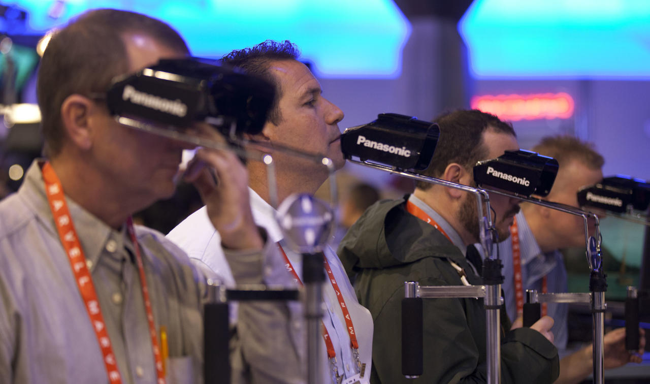 Buyers and industry affiliates watch a Panasonic 3D demo at the 2012 International Consumer Electronics Show, Wednesday, Jan. 11, 2012, in Las Vegas. (AP Photo/Julie Jacobson)