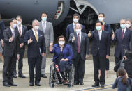 Taiwan's Foreign Minister Joseph Wu, second right front row, gestures with U.S. senators to his right, Democratic Sen. Christopher Coons of Delaware, a member of the Foreign Relations Committee, Democratic Sen. Tammy Duckworth of Illinois and Republican Sen. Dan Sullivan of Alaska, members of the Armed Services Committee on their arrival at the Songshan Airport in Taipei, Taiwan on Sunday, June 6, 2021. The bipartisan group of three U.S. senators arrived in Taiwan to meet with senior government officials and discuss U.S.-Taiwan relations and other issues in a trip that is likely to anger China, which claims Taiwan as its territory and objects to Taiwan being called a country. (Pool Photo via AP)