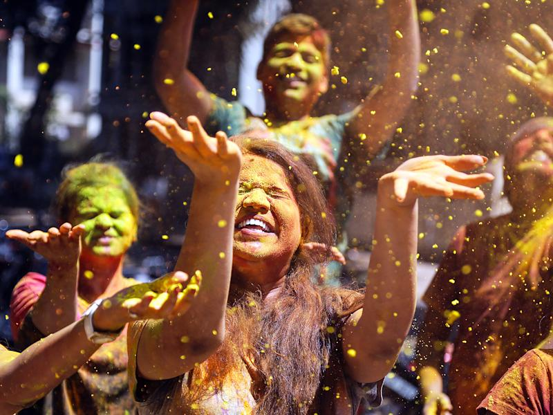 Indian revellers covered with powdered colours celebrate the Holi festival in Mumbai, India: Getty Images