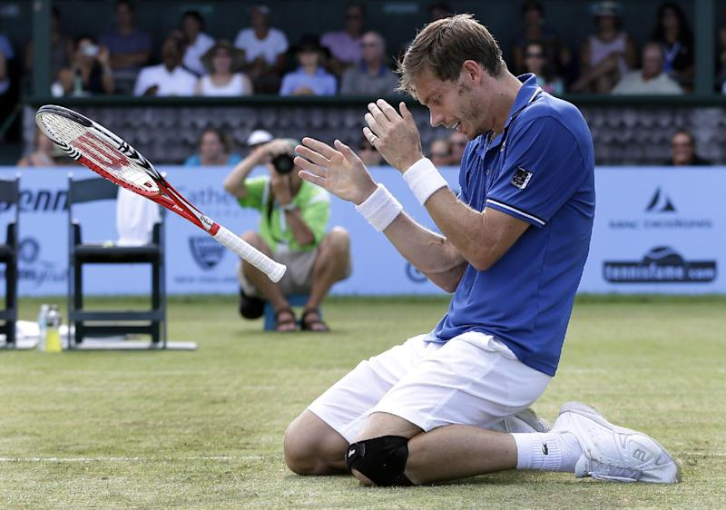 Nicolas Mahut, of France, reacts after defeating Lleyton Hewitt, of Australia, in the finals of the Hall of Fame Tennis Championships in Newport, R.I. Sunday, July 14, 2013. Mahut won 5-7, 7-5, 6-3. (AP Photo/Elise Amendola)