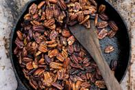 """Need something to <a href=""""https://www.epicurious.com/holidays-events/this-is-your-official-thanksgiving-snacking-strategy-article?mbid=synd_yahoo_rss"""" rel=""""nofollow noopener"""" target=""""_blank"""" data-ylk=""""slk:snack on in the kitchen while you cook"""" class=""""link rapid-noclick-resp"""">snack on in the kitchen while you cook</a>? The low oven temp and long bake time allow these nuts to take on rich flavor without burning. <a href=""""https://www.epicurious.com/recipes/food/views/buttery-cayenne-pecans-56390128?mbid=synd_yahoo_rss"""" rel=""""nofollow noopener"""" target=""""_blank"""" data-ylk=""""slk:See recipe."""" class=""""link rapid-noclick-resp"""">See recipe.</a>"""