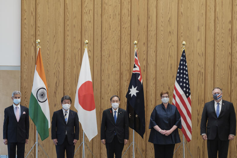 From left to right, Indian Minister of External Affairs Subrahmanyam Jaishankar, Japanese Foreign Minister Toshimitsu Motegi, Japanese Prime Minister Yoshihide Suga, Australian Foreign Minister Marise Payne and U.S. Secretary of State Mike Pompeo pose for a picture before a four Indo-Pacific nations' foreign ministers meeting at the prime minister's office in Tokyo Tuesday, Oct. 6, 2020. (Nicolas Datiche/Pool Photo via AP)